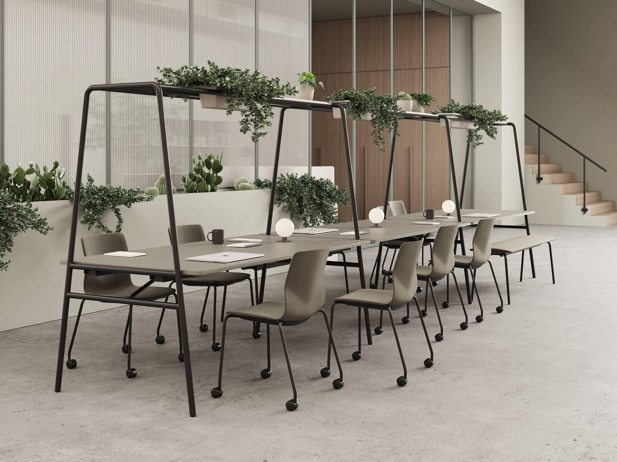Table design ARCHE pour le coworking, avec jardinière de plantes intégrées.